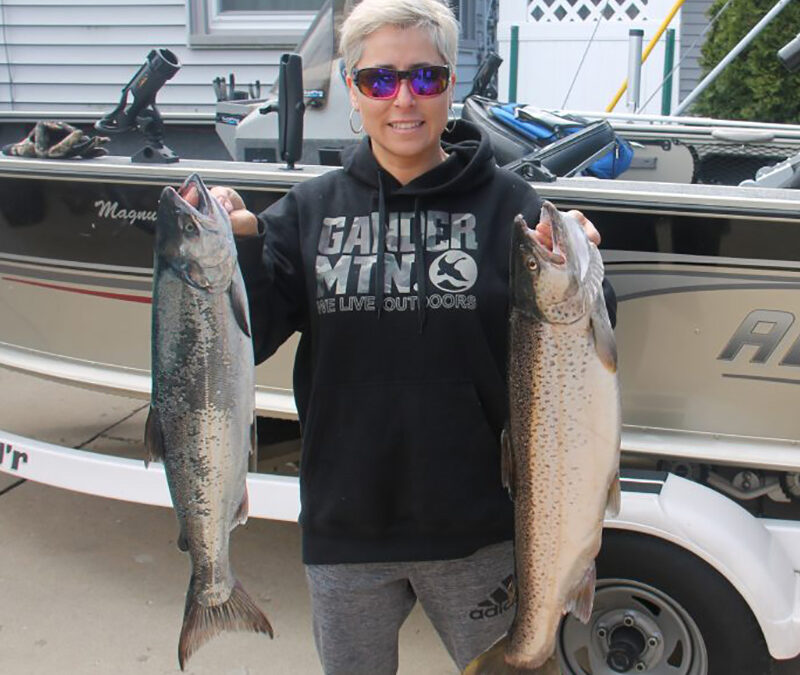 Happy client after a great day of fishing on Lake Michigan